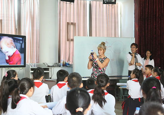 Julie Casey gives a Social Emotional Learning demo lesson in Zhong County, Chongqing.
