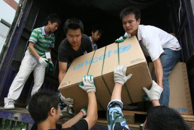 UNICEF volunteers help to deliver supplies after a natural disaster.