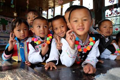 Girls and boys smiling in classroom, China