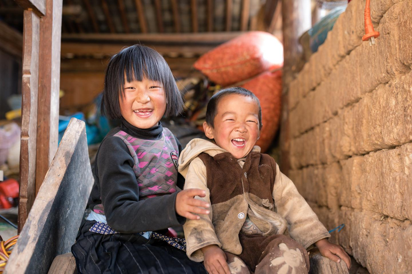 Girl and boy laughing, China