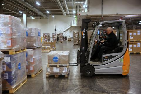 Personal Protective Equipment (PPE) including masks and protective suits are being packed and loaded in UNICEF's global supply hub in Copenhagen on 28 January 2020.