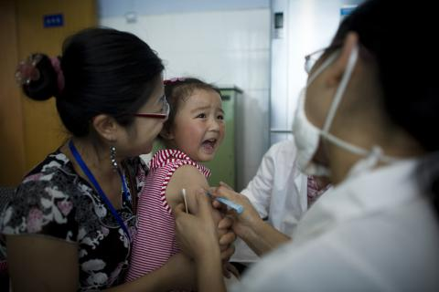 A girl cries while being vaccinated at Sichuan University in Chengdu, the provincial capital.