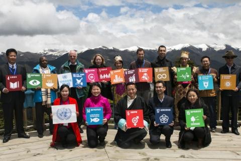 Participants at the Symposium hold the 17 icons representing the Sustainable Development Goals.
