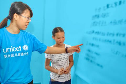 UNICEF volunteer teaching in school, China.