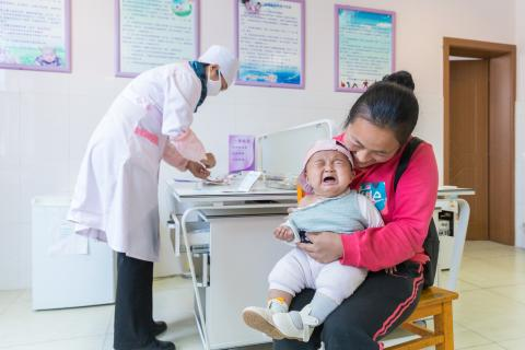 In March 2018, a child was receiving vaccination in Yulong county's health center.