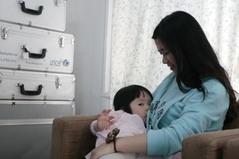 A mother breastfeeds her baby at the breastfeeding room of UNICEF China in Beijing in 2013.