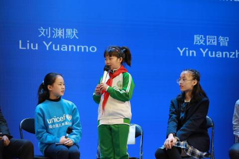 Mu Yuxuan (standing), 9 years old, speaks at a panel discussion during the 'Climate Change: Youth in Action' forum in Beijing on 20 November 2020. Held at the China National Children's Center, the forum was co-hosted by UNICEF, the All-China Youth Federation and the Ministry of Ecology and Environment in celebration of World Children's Day. It aims to raise awareness of the environmental issues that most affect young people and hear their voices and solutions for change.