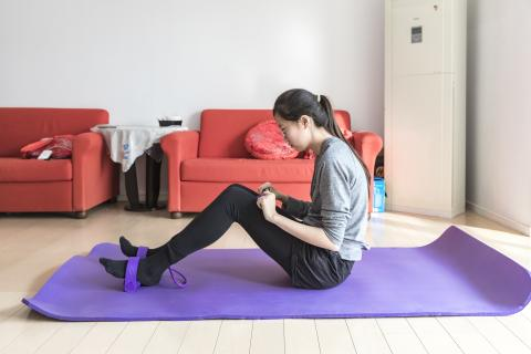 A girl from Beijing does exercise at her home on 18 February 2020.