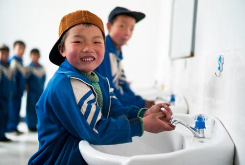 Children use clean water facilities and sanitary latrines in Xihe County.