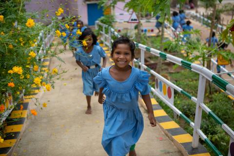 Deepika Jakaka, a 1st grader, plays with her classmates at the wonderfully green courtyard of the Ramachandrapur upper primary school in Rayagada district, Odisha.