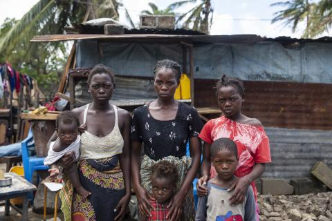 On 21 March 2019 in Mozambique, (back row) Anna Francesco holds her daughter Tina Fransesco, Clara Fransesco, Tija Fransesco, (bottom row) Regina Francesco and Emmanuel Francesco stands in front of a temporary shelter that they built in Beira.