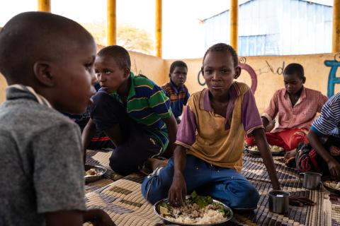 Children eat school-provided lunch at Qanshalay Primary School in Dollow, Somalia, Tuesday, April 23, 2018.