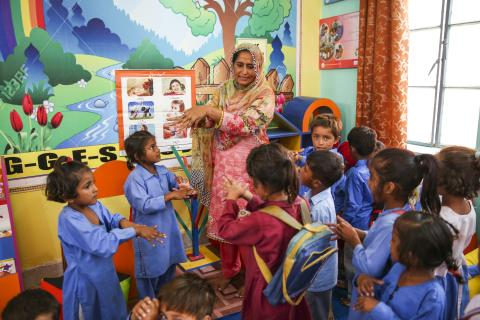 Khalida Kamil, assistant teacher teaching hand washing steps to the students of Early Childhood (ECE) class in government girls elementary school Khato Kalan in Toba take sing district, Punjab province, Pakistan.