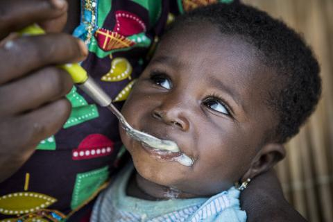 Chatou Dembele, 6 months old, eats porridge enriched with micronutrient powder in Mali.