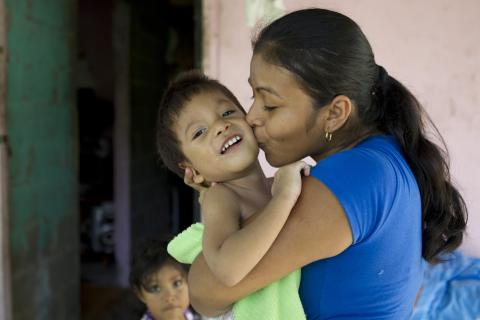 Delfina Sanchez kisses her 2-year-old son, Ecni 'Jesus' Gonzalez Sanchez, who has cerebral palsy, at home in La Chorrera District in Panama Province.