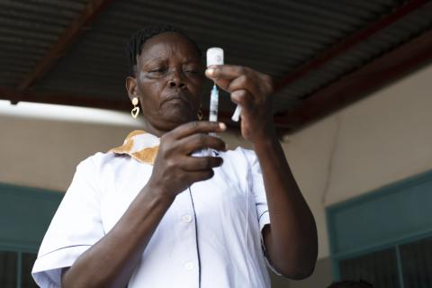 On 24 March 2020, nurse Lillian Nimaya, 45, fills a syringe with a vaccine at Nyakuron Primary Health Care Centre in Juba, South Sudan.