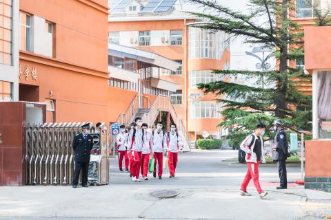 Students of a high school in Beijing, China, leave school on 27 April 2020, the first day classes are resumed for graduating high school students in the city.
