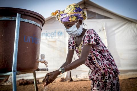 Hamsatou Bolly, 13, washes her hands at the Socoura displacement camp in Mopti.