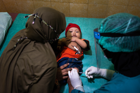 On 16 June 2020, a child is vaccinated at the Tegalrejo Community Health Centre in Yogyakarta, Indonesia.