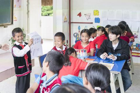 A student presents the results from a group discussion on how to help victims of school bullying to the class at Xinzhai Primary School in Cangyuan, Yunnan Province, on 13 July, 2019.