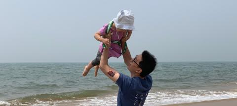 A father holds his daughter in Qinhuangdao, Hebei Province, in 2019.