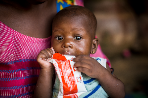 Aissata Kanitao, 6 months, eats ready-to-use therapeutic food at her home in Mopti, central Mali.