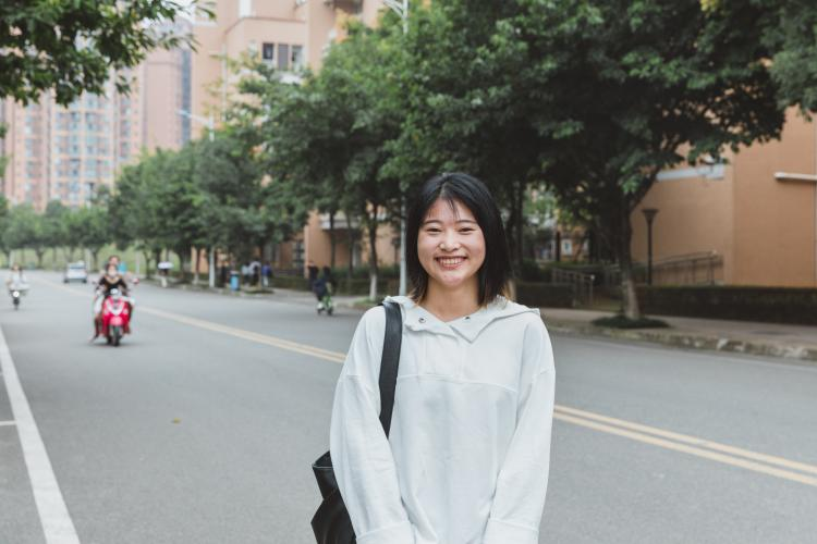 Lamei, 22, is photographed at the Chengdu University of Technology in Chengdu, Sichuan Province.