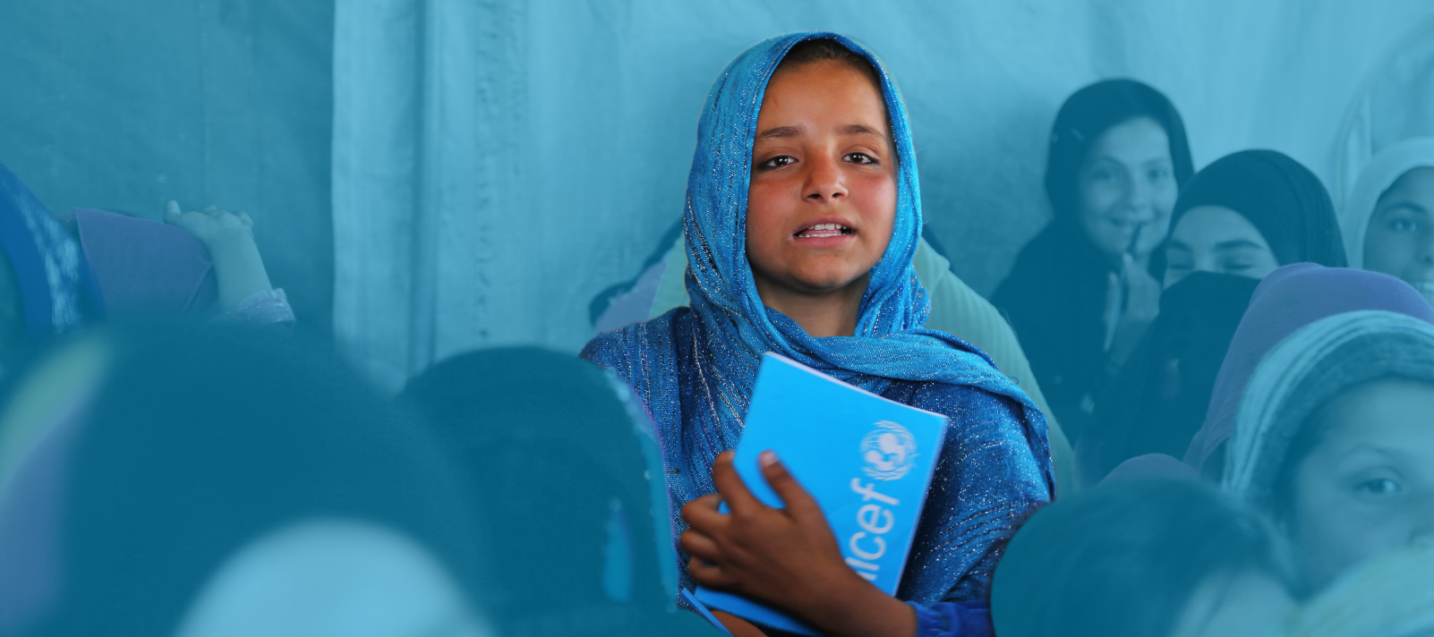 A 10-year-old girl sits in a tented class at a community-based school in Laghman, Afghanistan, in 2017.