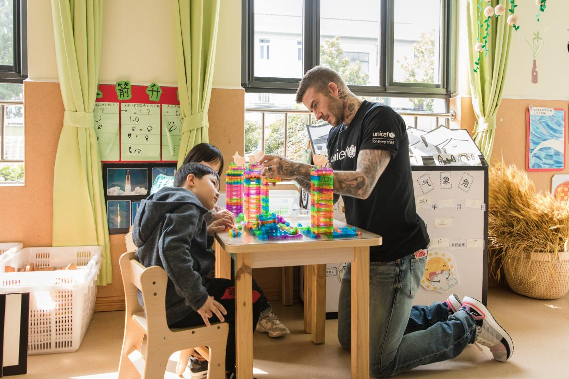 UNICEF Goodwill Ambassador and Global Icon David Beckham and two 6-year-old children play with building blocks during a visit to Xianghuaqiao Kindergarten on the outskirts of Shanghai, China, on 27th March 2019.