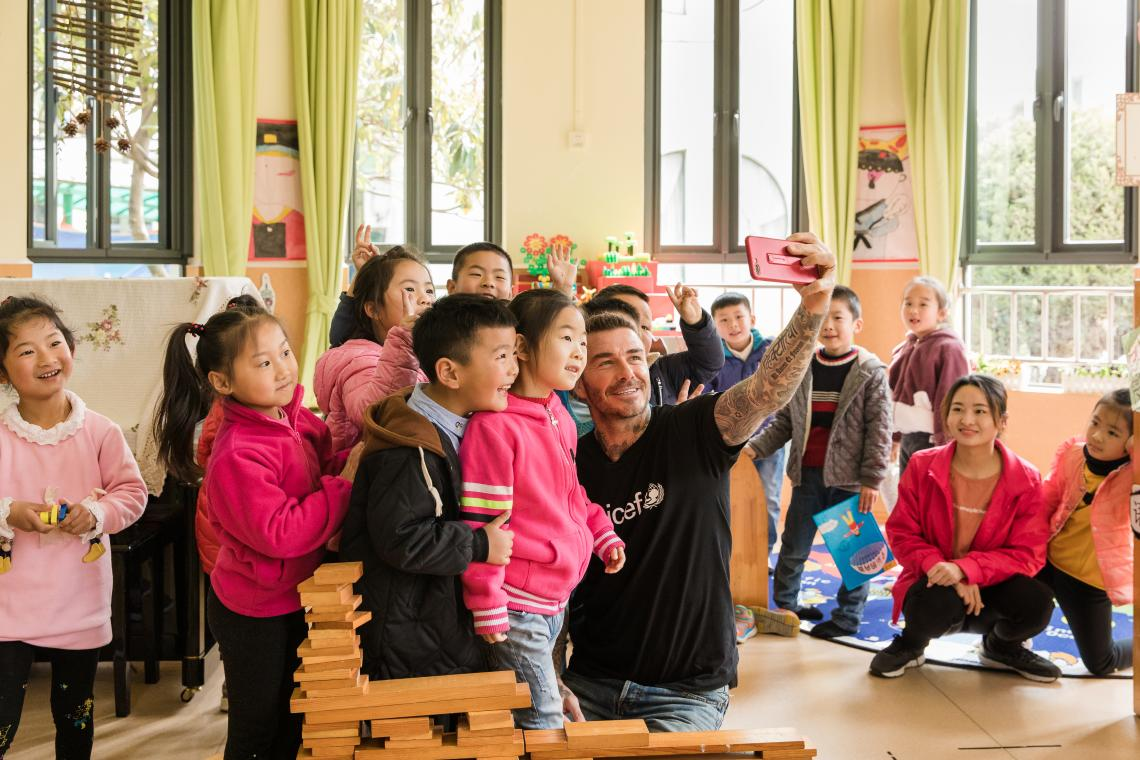 UNICEF Goodwill Ambassador and Global Icon David Beckham takes a selfie with a group of children during a visit to Xianghuaqiao Kindergarten on the outskirts of Shanghai, China, on 27th March 2019.