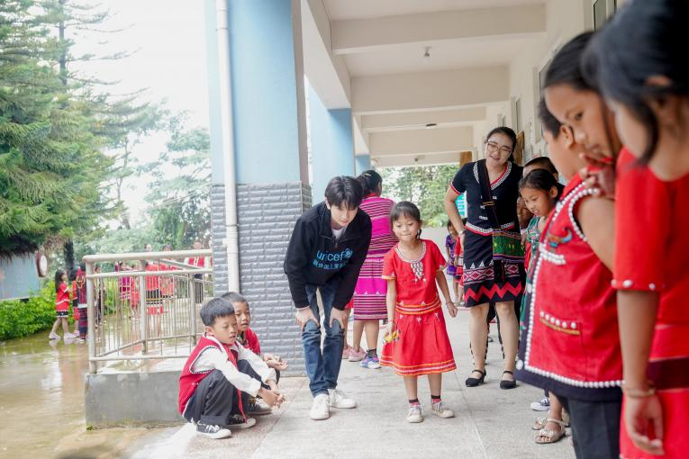 UNICEF Ambassador Wang Yuan joins a game with students during his visit to Xinzhai Primary School in Cangyuan, Yunnan Province, where UNICEF is implementing a Social and Emotional Learning project, on 13th July, 2019.