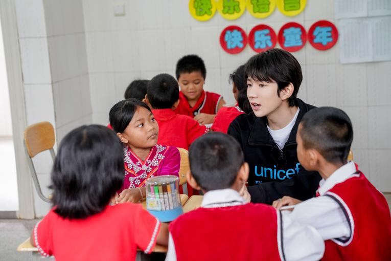 UNICEF Ambassador Wang Yuan joins a group discussion in a Social and Emotional Learning lesson during his visit to Xinzhai Primary School in Cangyuan, Yunnan Province, where UNICEF is implementing a Social and Emotional Learning project, on 13th July, 2019.