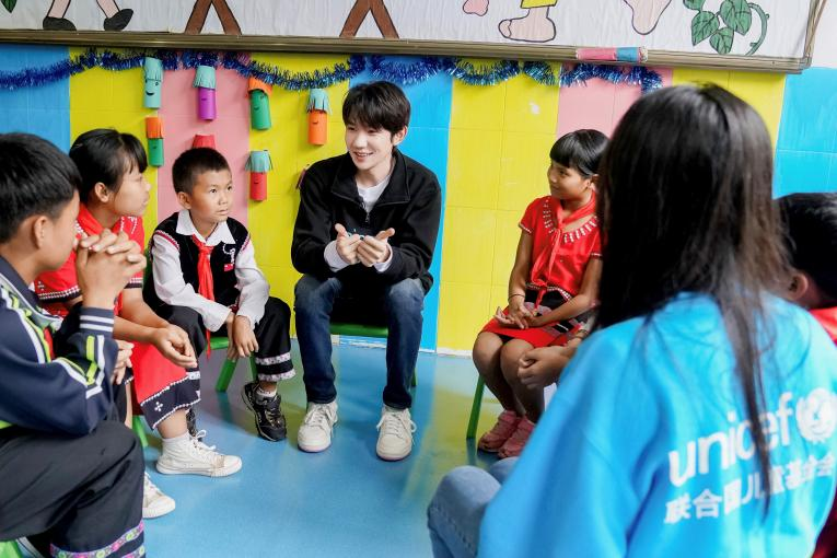 UNICEF Ambassador Wang Yuan shares his opinions on how to deal with bullying with a group of students during his visit to Xinzhai Primary School in Cangyuan, Yunnan Province, where UNICEF is implementing a Social and Emotional Learning project, on 13th July, 2019.