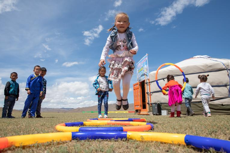 Children play outdoors at the newly opened mobile 'ger' (traditional nomadic tent) kindergarten in the Janjin bagh area, in Erdenetsogt soum in Bayankhongor Province, Mongolia, on 17 June 2018.
